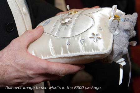 cushion with wedding rings, £300 wedding photos package